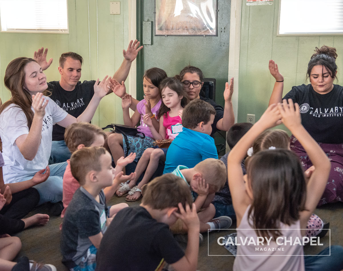 Students worship with kids