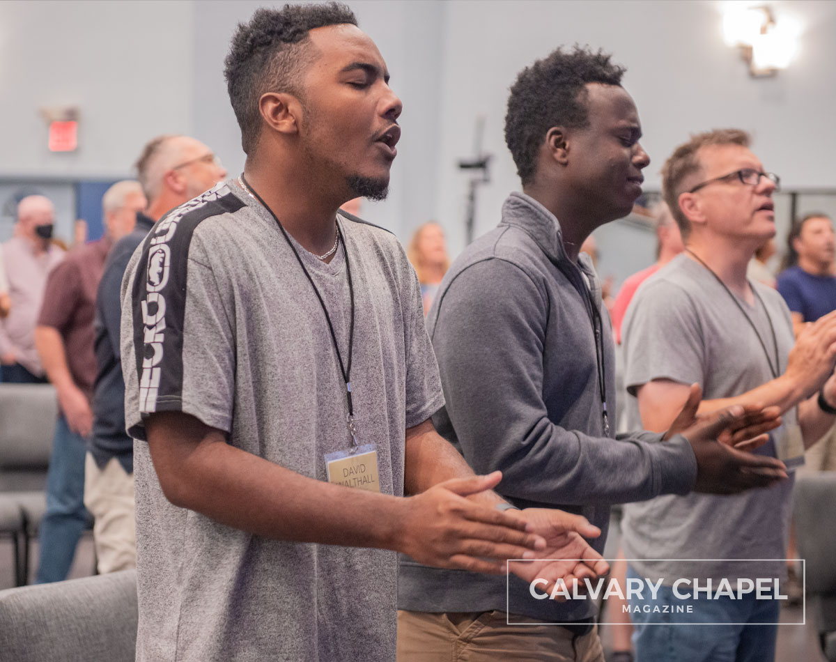 Young men worshiping