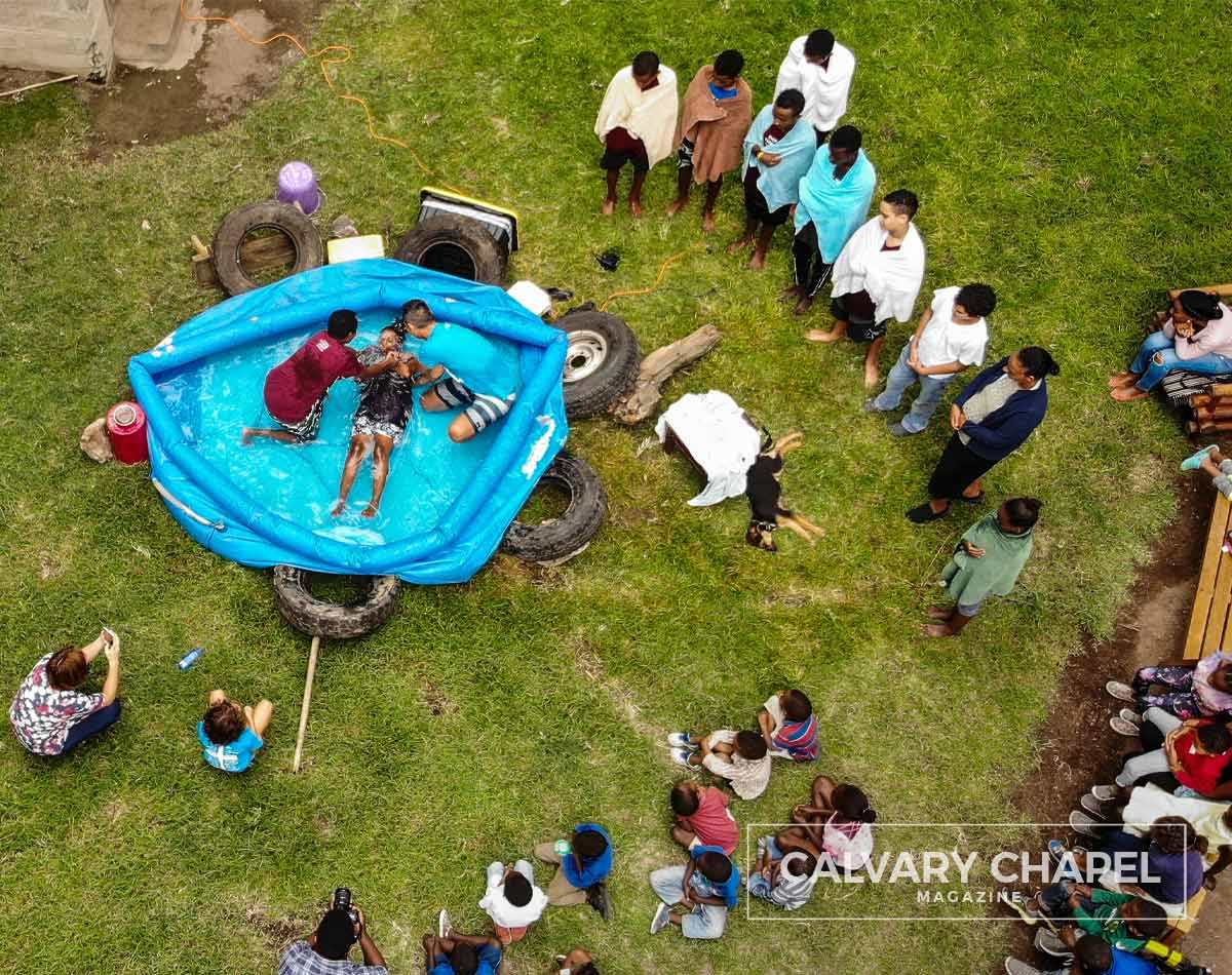 Baptism in small pool in yard