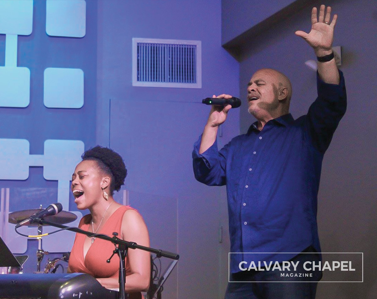 Pastor Robert and Erica singing to the Lord