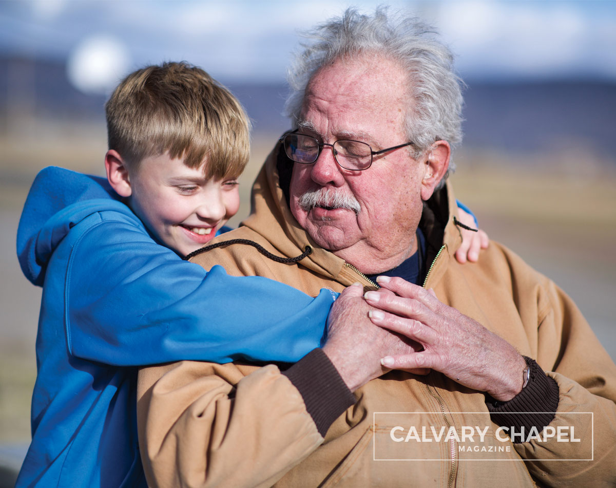 Boy hugging his grandfather