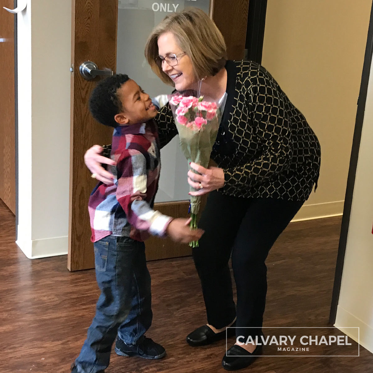 Woman receives flowers from boy