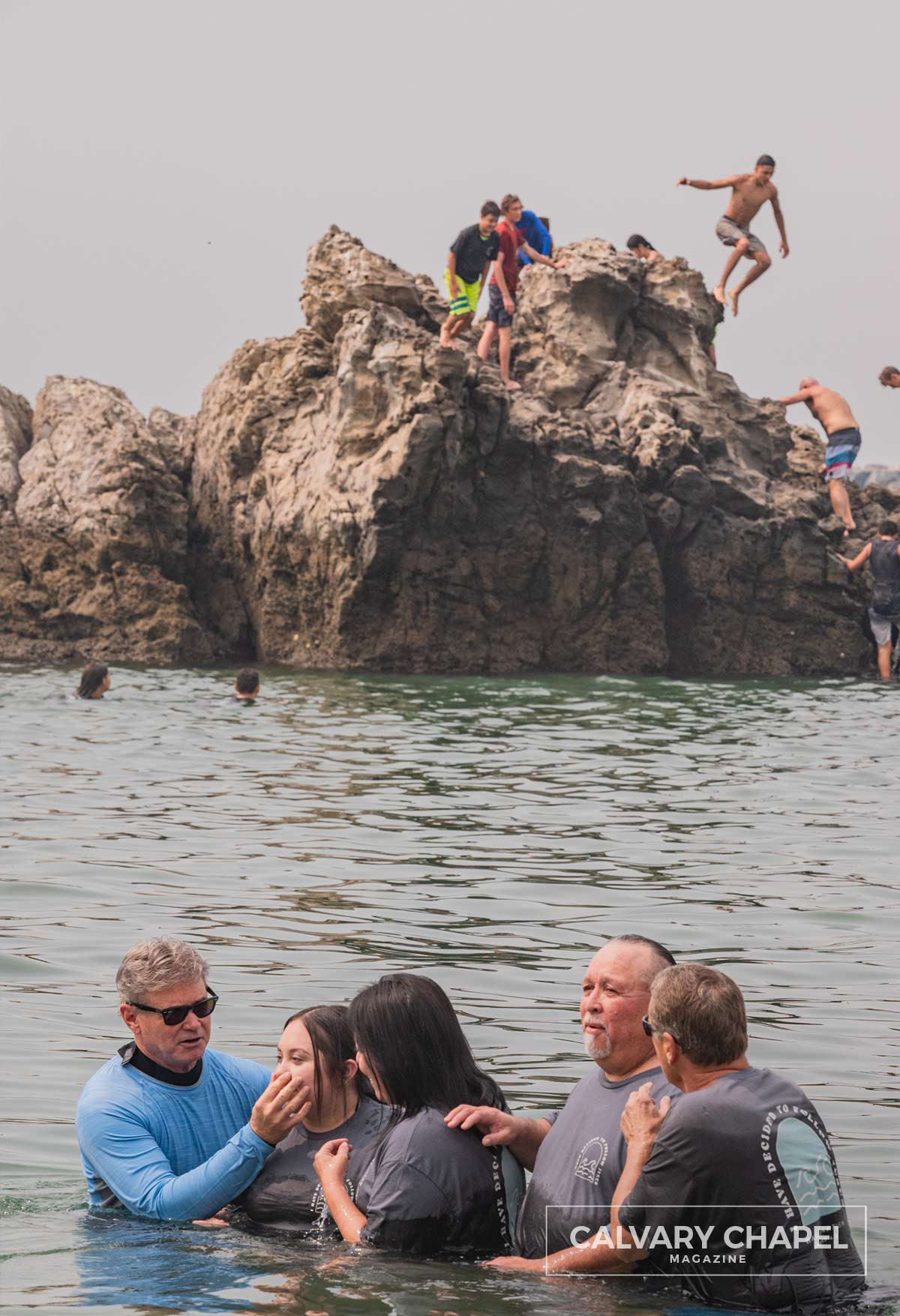 Pastor Jack baptizing people and kids jumping off rocks