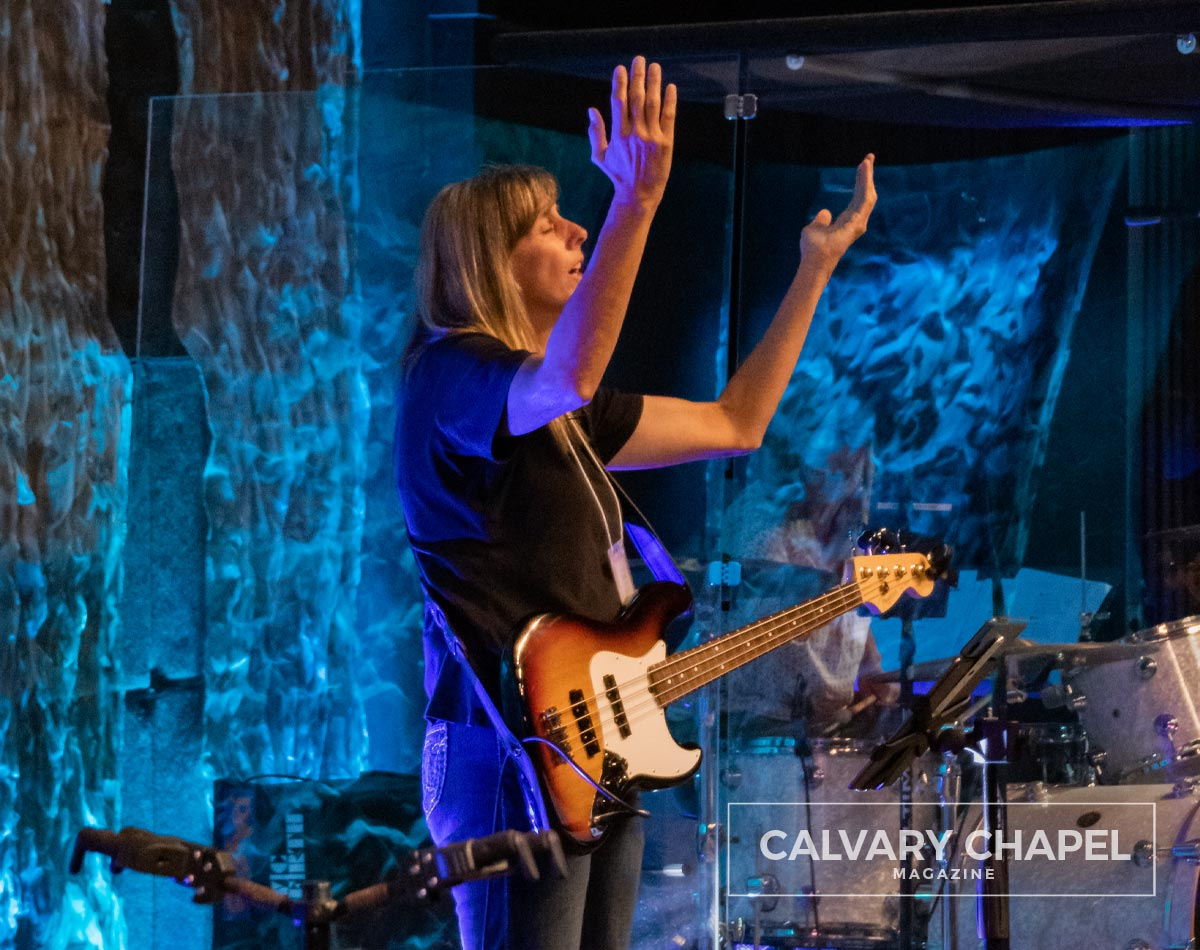 Woman raising her arms in worship