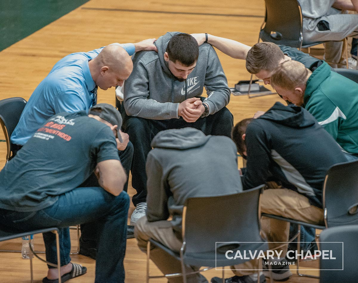group of men prays