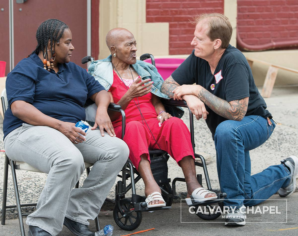 Larry talks with ladies at outreach