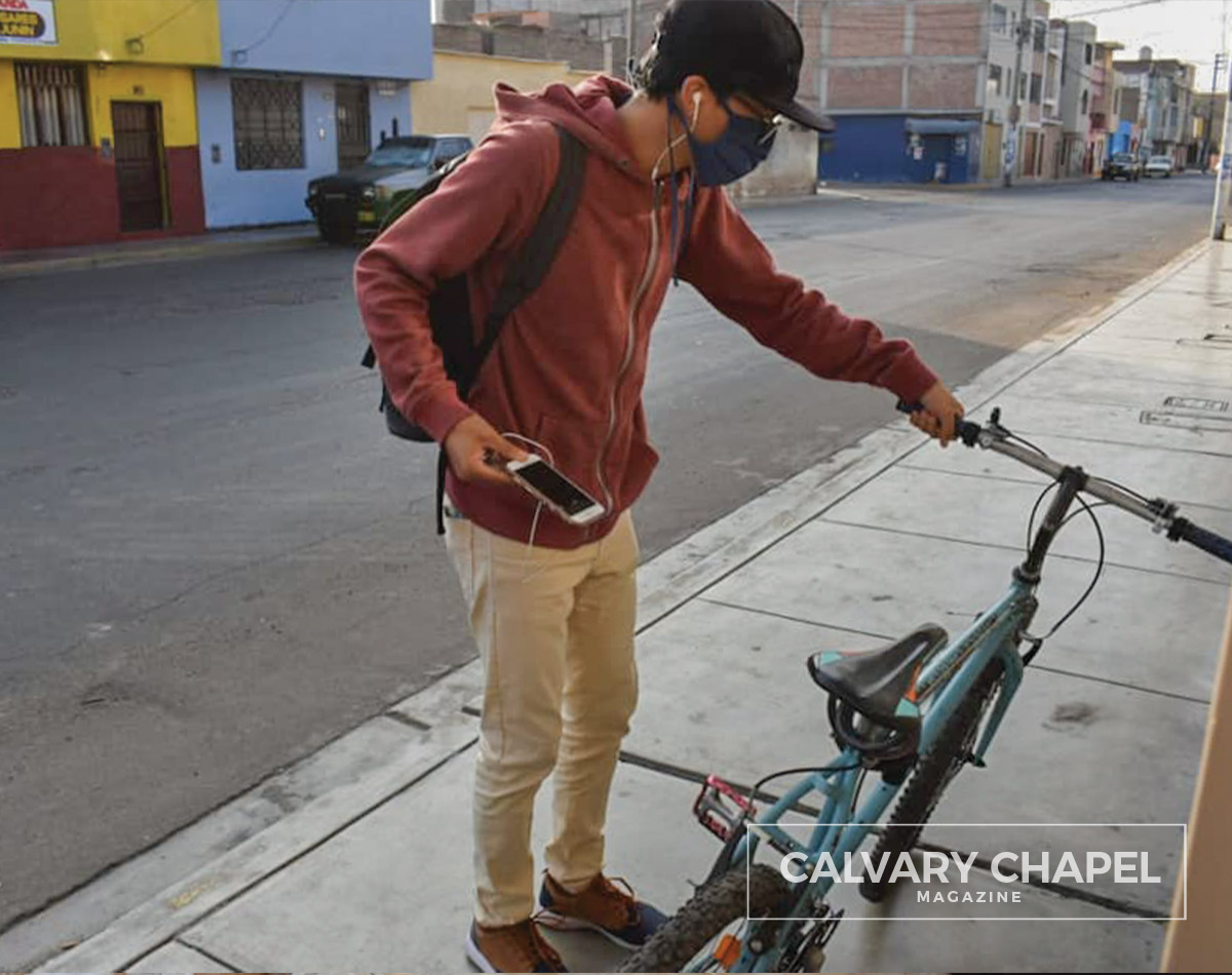 missionary delivers food on bike