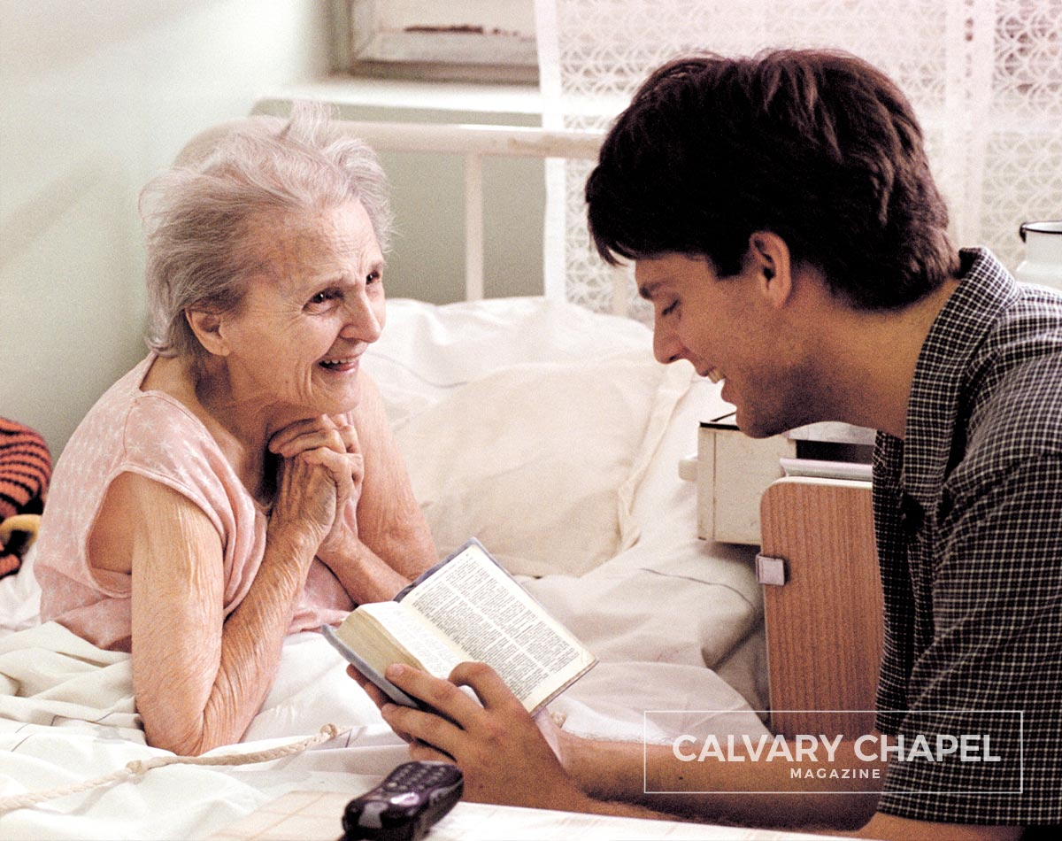 Sharing the Gospel with a happy elderly woman