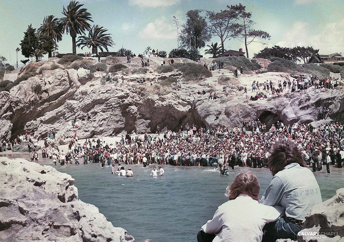 Hundreds routinely gathered for baptisms during the late 1960s and early '70s, necessitating that Calvary Chapel relocate baptisms from their building to Pirate's Cove in Newport Beach, CA.
