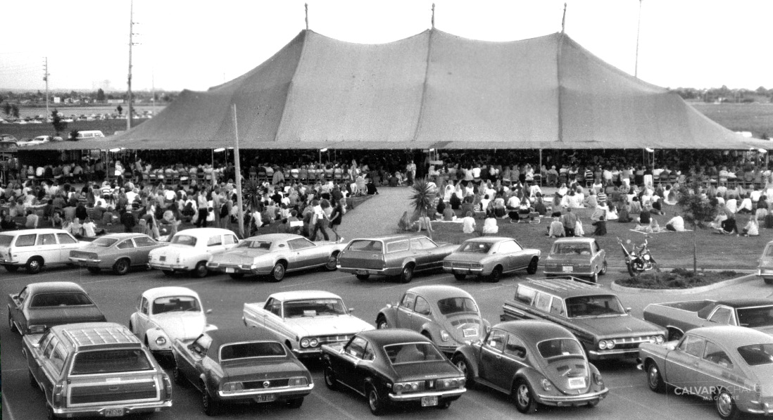 "Calvary Chapel's parking lot was routinely crowded with cars during ""the Tent"" days, after the church's growth from 25 to 2,000 necessitated meeting in a tent for a few years during the early 1970s."