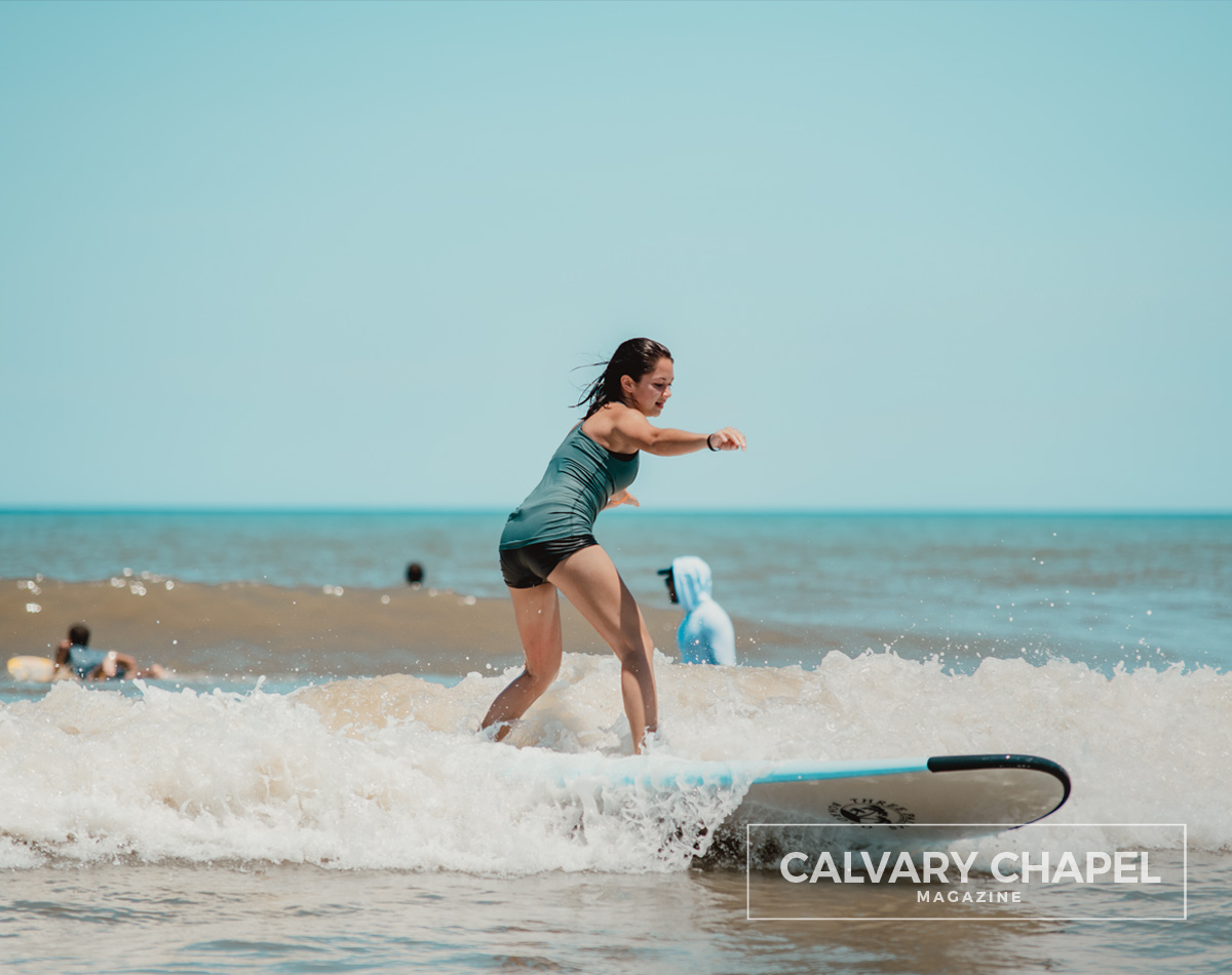 Girl surfing it up