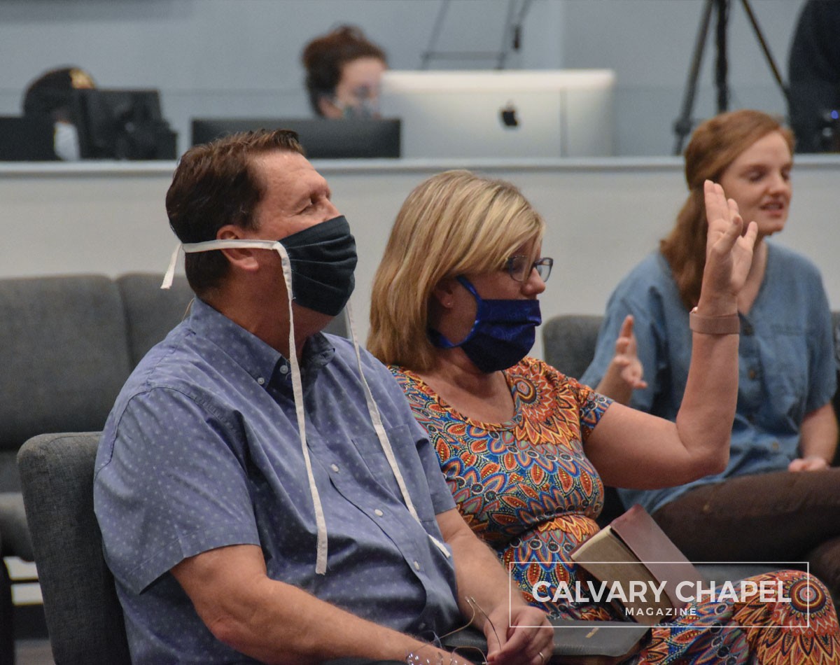 Pastor Sandy and his wife sitting with masks on