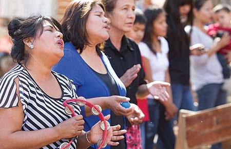 Ladies at Rancho Maranatha church in Mexico worship the Lord.